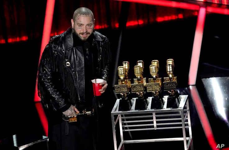 Post Malone appears on stage with his nine awards to include top male artist and top artist at the Billboard Music Awards on…