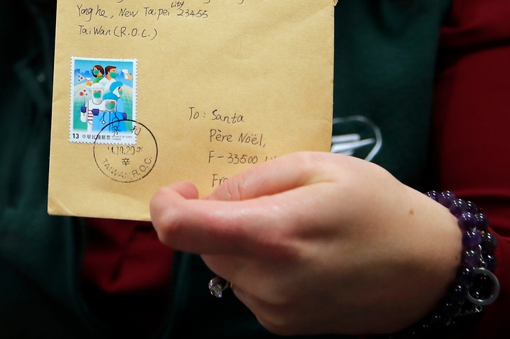 """An envelope from Taiwan addressed to """"Pere Noel"""" - Father Christmas in French -  decorated with love hearts, stickers and…"""