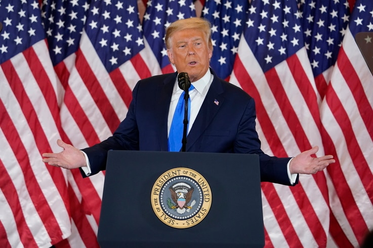 President Donald Trump speaks in the East Room of the White House, early Wednesday, Nov. 4, 2020, in Washington. (AP Photo/Evan…