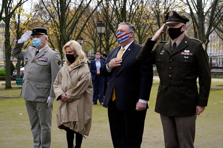 U.S. Secretary of State Mike Pompeo, second from right, pauses as he participates in a wreath-laying ceremony in homage to…