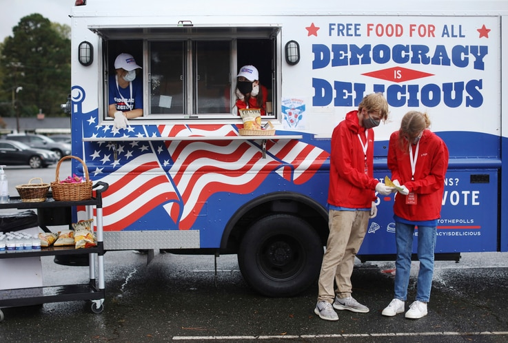 IMAGE DISTRIBUTED FOR PIZZA TO THE POLLS -  Young people are joining the efforts to deliver free food and drink to voters…