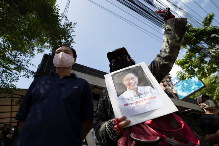 Activists gather for a rally with a photo of Thai dissident Wanchalearm Satsaksit in front of Cambodian Embassy in Bangkok,…
