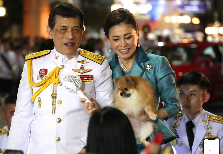 Thai King Maha Vajiralongkorn, left and Queen Suthida, right meet supporters after attending a ceremony to mark an anniversary…