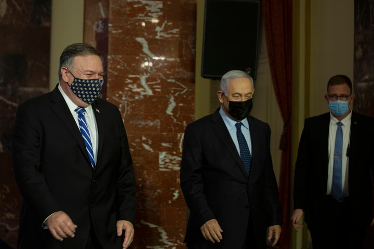 U.S. Secretary of State Mike Pompeo, left, and Israeli Prime Minister Benjamin Netanyahu leave after making a joint statement…