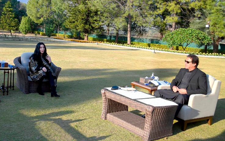 In this photo provided by Press Information Department, U.S. Iconic singer and actress Cher, left, talks to Pakistan Prime…