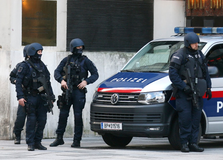 After a shooting armed police officers stand on a street at the scene in Vienna, Austria, Tuesday, Nov. 3, 2020. Police in the…