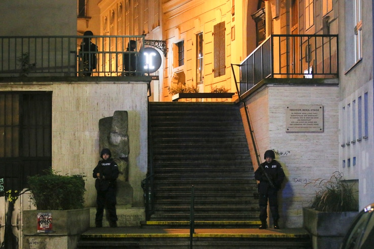 Police officers stay in position at stairs named 'Theodor Herzl Stiege' near a synagogue after gunshots were heard, in Vienna,…