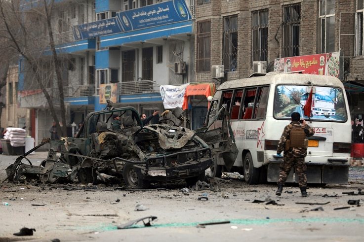 Afghan security personnel inspect the site of a bomb attack in Kabul, Afghanistan, Saturday, Dec. 26, 2020. A series of…