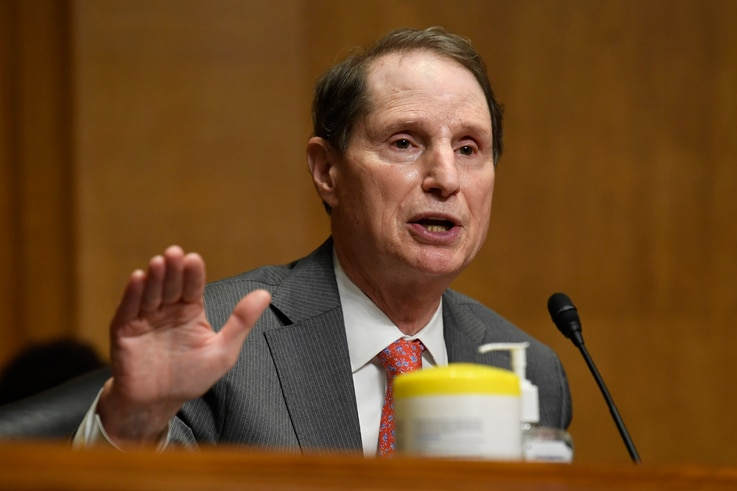 Sen. Ron Wyden, D-Ore., questions Internal Revenue Service Commissioner Charles Rettig at a Senate Finance Committee hearing on...
