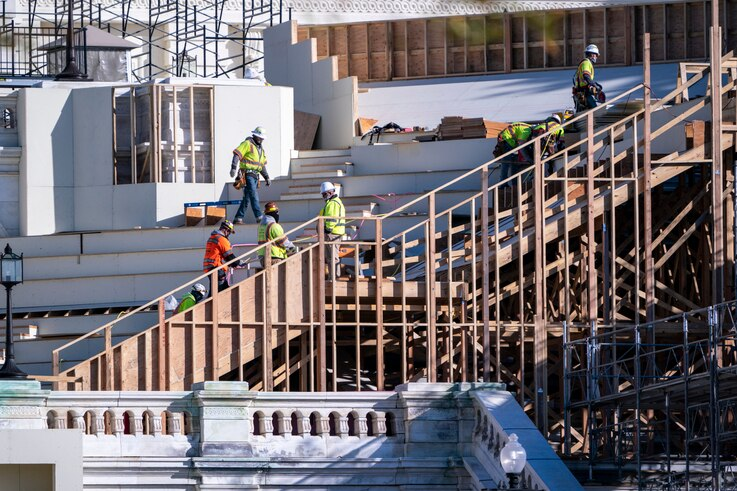With Inauguration Day two months away on Jan. 20, 2021, construction crews work on the platforms where the president-elect will…