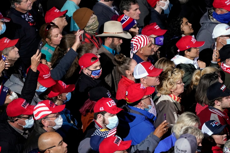 Supporters listens as President Donald Trump speaks at a campaign rally for Senate Republican candidates, Sen. Kelly Loeffler,…