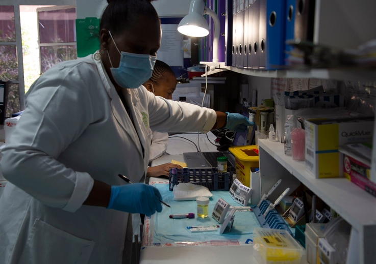 Laboratory technicians test a blood sample for HIV infection at the Reproductive Health and HIV Institute (RHI) in Johannesburg…