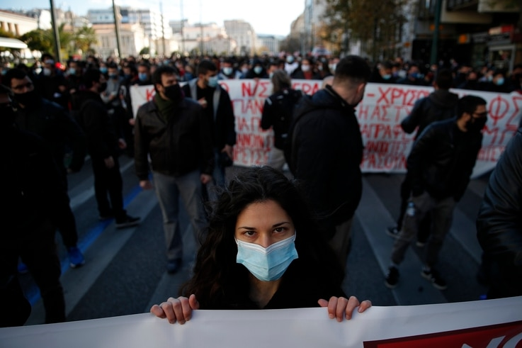 A university student holds a banner during a rally against education reforms in Athens, Thursday, Jan. 28, 2021. Thousands of…