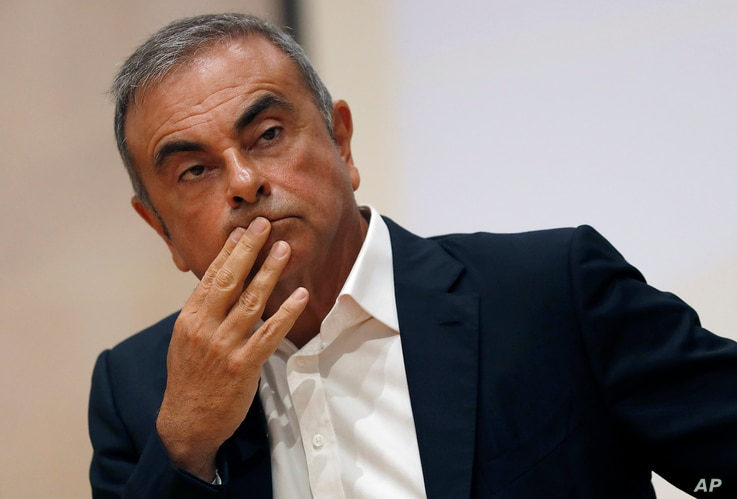 FILE - In this Sept. 29, 2020, file photo, former Nissan Motor Co. Chairman Carlos Ghosn holds a press conference at the...