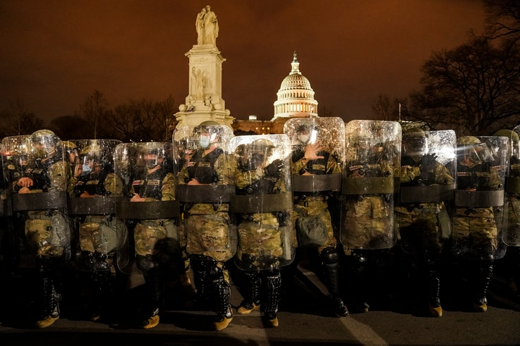 District of Columbia National Guard stand outside the Capitol, Wednesday night, Jan. 6, 2021, after a day of rioting protesters…