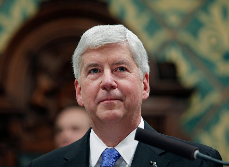 FILE - In this Jan. 23, 2018, file photo, former Michigan Gov. Rick Snyder delivers his State of the State address at the state...