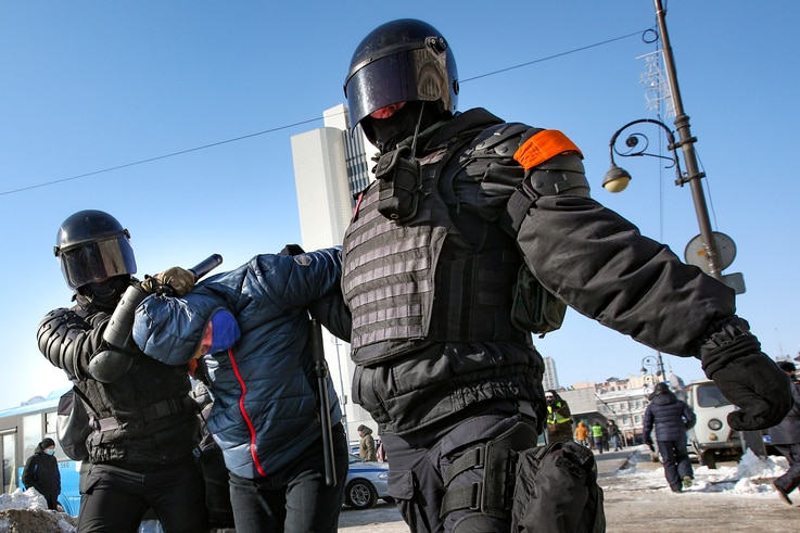 Police officers detain a man during a protest against the jailing of opposition leader Alexei Navalny in Vladivostok, Russia,…