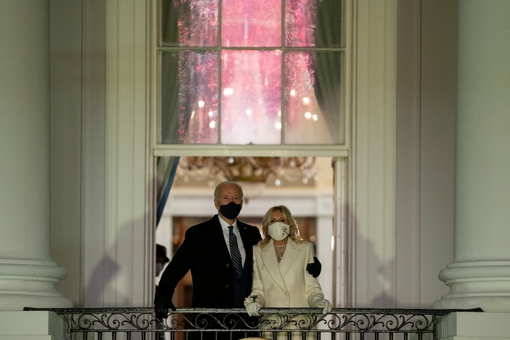 President Joe Biden and first lady Jill Biden watch fireworks from the White House, Wednesday, Jan. 20, 2021, in Washington. ...