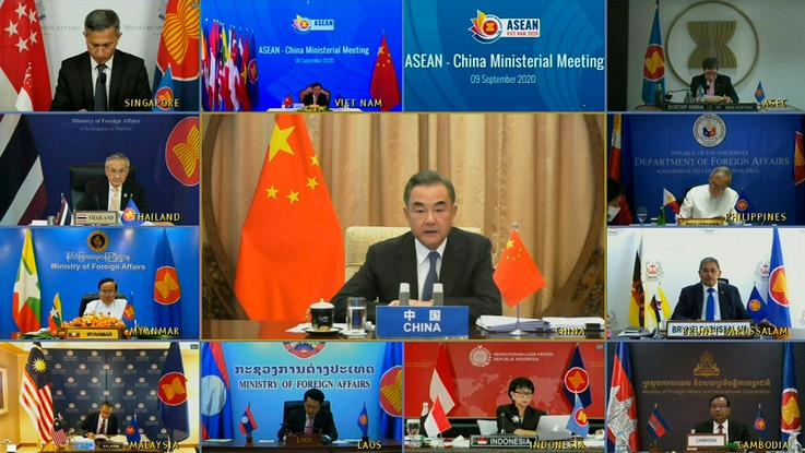 In this image taken from video provided by VTV, Chinese Foreign Minister Wang Yi speaks during an online meeting with ASEAN…