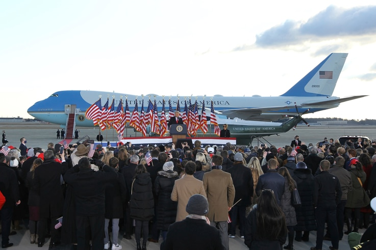 A small crowd of supporter gather to watch President Donald Trump and first lady Melania Trump board Air Force One at Andrews...