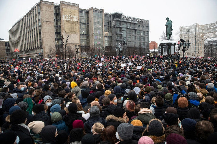 People gather in Pushkin Square during a protest against the jailing of opposition leader Alexei Navalny in Moscow, Russia,...