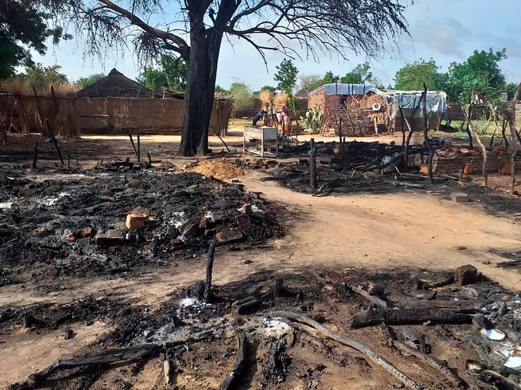 FILE - This photo shows aftermath of an attack in the village of Masteri in west Darfur, Sudan, July 25, 2020.