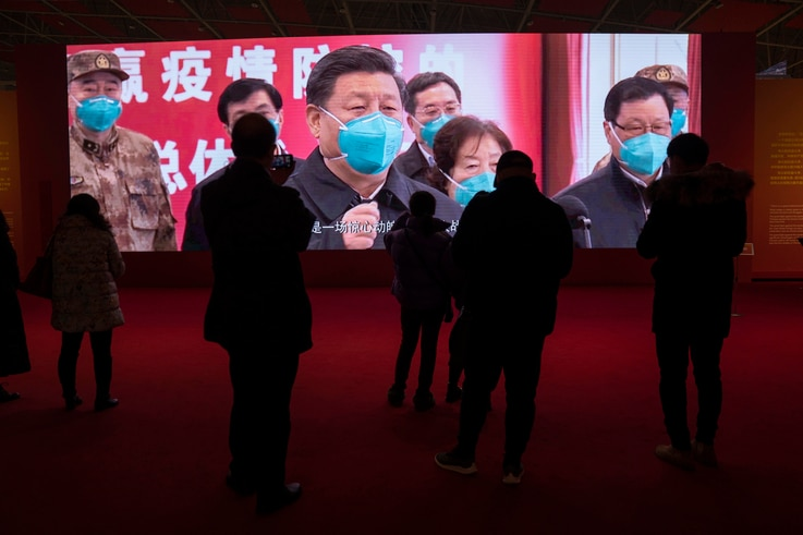 Residents attend an exhibition on the city's fight against the coronavirus in Wuhan in central China's Hubei province on…