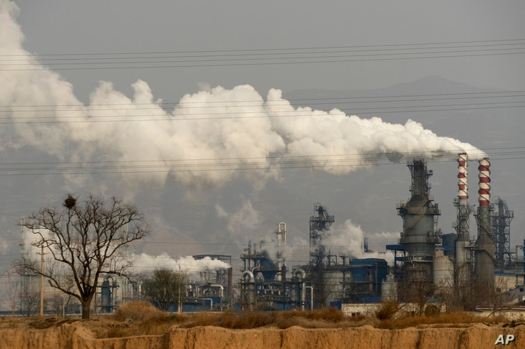 CORRECTS TO REMOVE THE REFERENCES TO CARBON BLACK AND STEEL MANUFACTURING - In this Nov. 28, 2019 file photo, smoke and steam…