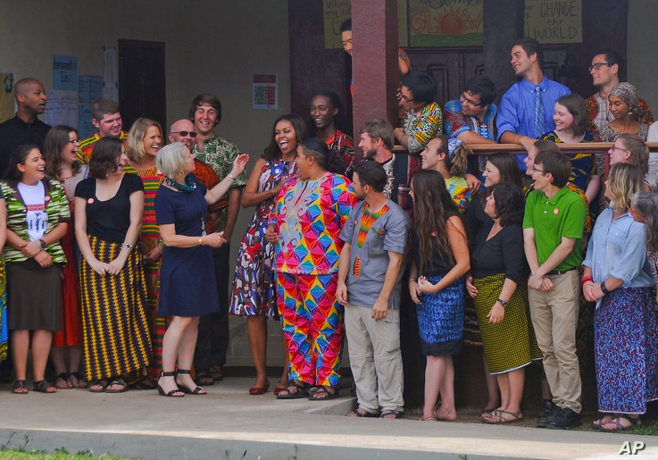 U.S. first lady Michelle Obama laughs with Peace Corps members at a project 70 kilometers (43 miles) from the capital city...