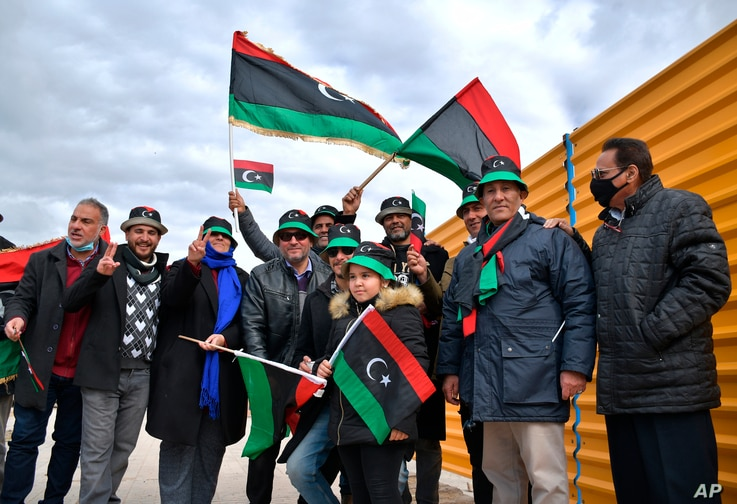 Libyans mark the 10th anniversary of their 2011 uprising that led to the overthrow and killing of longtime ruler Moammar…