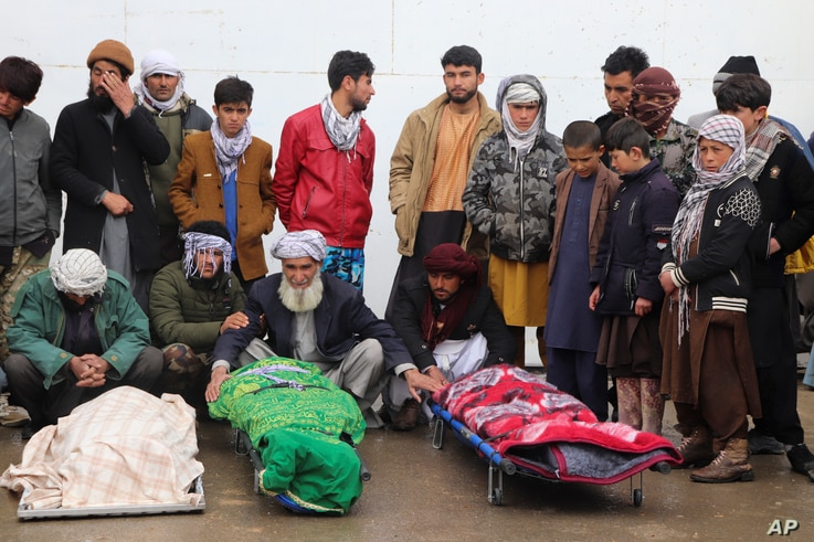 Afghans attend funeral of the family members of journalist Bismillah Adil Aimaq, who was shot dead in an unclaimed attack...