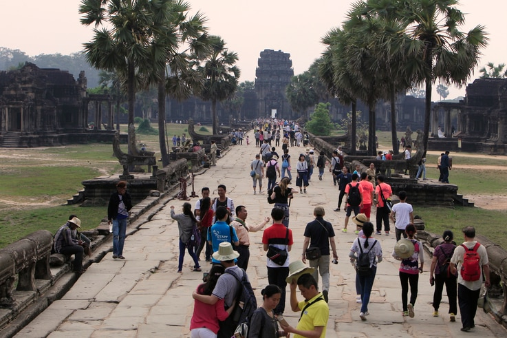 Tourists visit the Angkor Wat temple in Siem Reap, Cambodia, Wednesday, March 14, 2018. Cambodia's main tourist destination,…