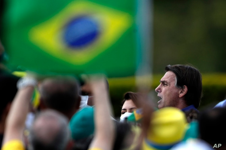 Brazil's President Jair Bolsonaro celebrates his 66th birthday with supporters at the Alvorada Palace, the official…