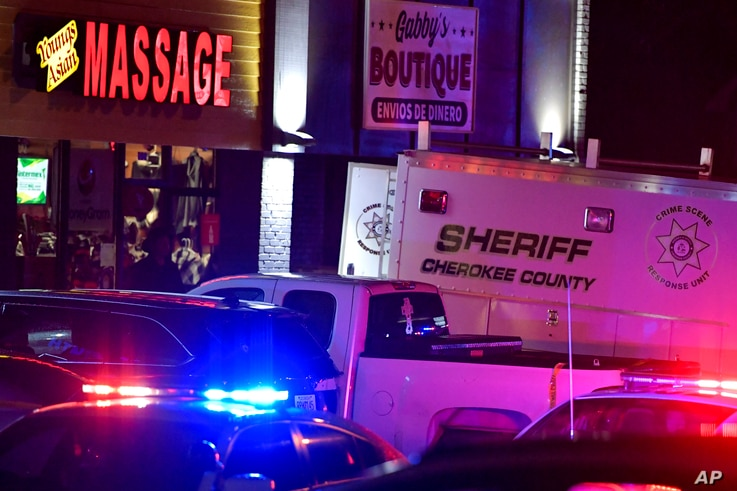 CORRECTS DATELINE TO ACWORTH INSTEAD OF WOODSTOCK - Authorities investigate a fatal shooting at a massage parlor, late Tuesday,…