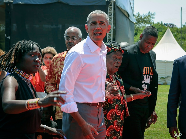 FILE — In this Monday, July 16, 2018, file photo, then U.S. President Barack Obama, center, with his half sister Auma Obama,...