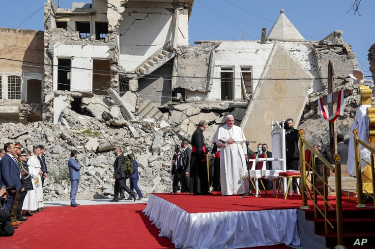 Pope Francis, surrounded by shells of destroyed churches, arrives to pray for the victims of war at Hosh al-Bieaa Church Square…