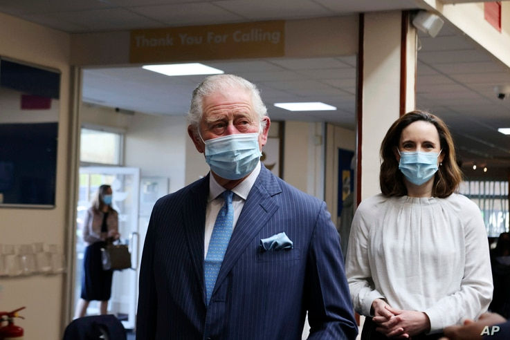 Britain's Prince Charles arrives for a visit to an NHS vaccine pop-up clinic at Jesus House church, London, Tuesday March 9,…