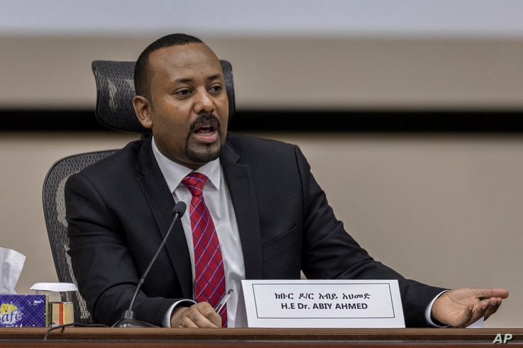FILE - In this Monday, Nov. 30, 2020 file photo, Ethiopia's Prime Minister Abiy Ahmed responds to questions from members of…