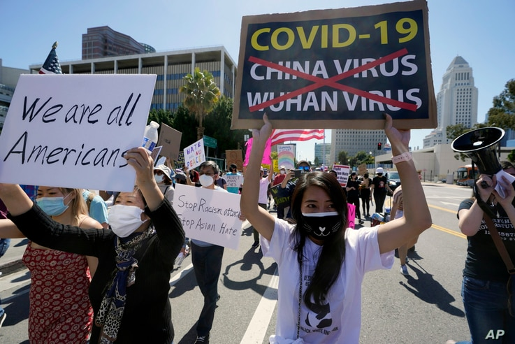 Protestors march at a rally against Asian hate crimes past the Los Angeles Federal Building in downtown Los Angeles , Saturday,…