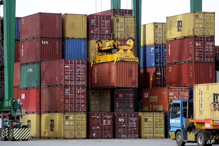 Ship containers are moved at the port of Sines, in Sines, southern Portugal, Feb. 12, 2020. (AP Photo/Armando Franca)