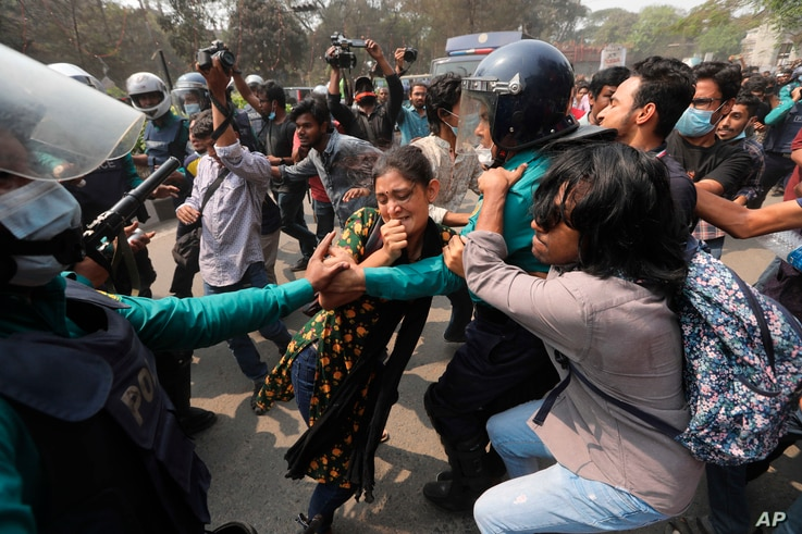 Bangladeshi students clash with police during a protest in Dhaka, Bangladesh, Monday, March 1, 2021. About 300 student...