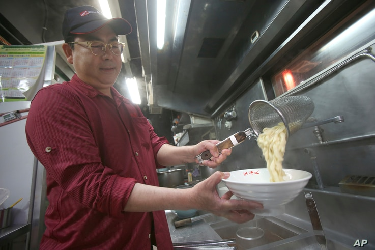 Chef Hung cooks pineapple beef noodle at his restaurant in Taipei, Taiwan, Wednesday, March 10, 2021. Hung Ching Lung, a Taipei…