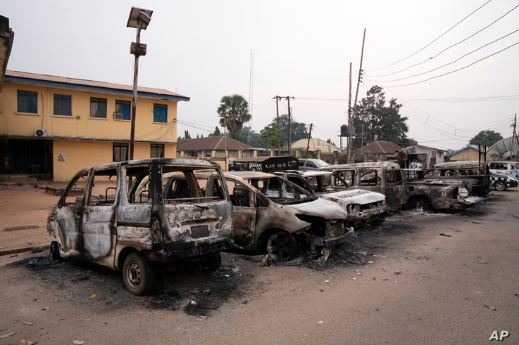 Burned vehicles are parked outside the police command headquarters in Owerri, Nigeria, on Monday, April 5, 2021. Hundreds of…