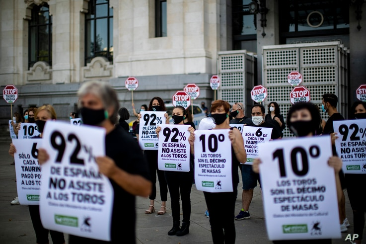 """People hold banners reading in Spanish: """"92% of Spain, don't attend the bullfights"""" during a protest against bullfighting in…"""