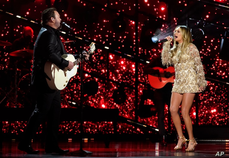 Lee Brice, left, and Carly Pearce perform at the 56th annual Academy of Country Music Awards on Sunday, April 18, 2021, at the…