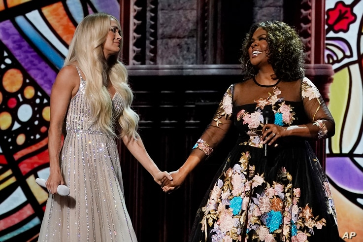 Carrie Underwood, left, and CeCe Winans perform at the 56th annual Academy of Country Music Awards on Saturday, April 17, 2021,…