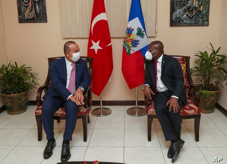 Turkey's Foreign Minister Mevlut Cavusoglu, left, speaks with Claude Joseph, Minister of Foreign Affairs of the Republic of…