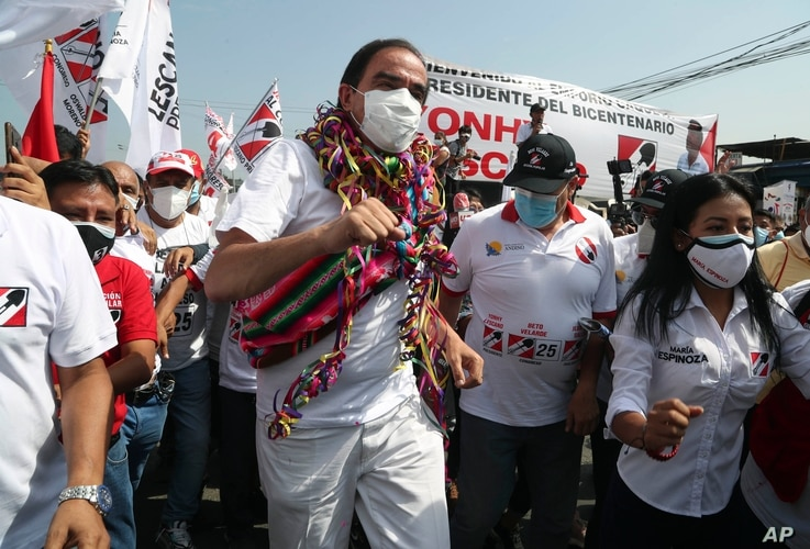 Popular Action party presidential candidate Yonhy Lescano dances while campaigning at the Caqueta market in Lima, Peru, Monday,…