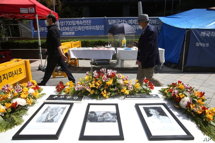 Portraits of the late former South Korean comfort women are displayed near Japanese Embassy in Seoul, South Korea, Wednesday,…