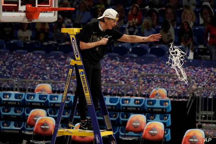 Stanford head coach Tara VanDerveer cuts down the net after the championship game against Arizona in the women's Final Four…